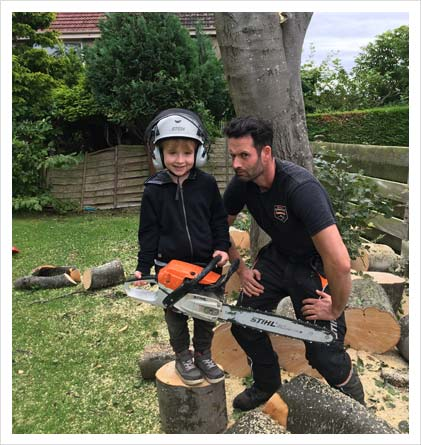 adult and child with chainsaw